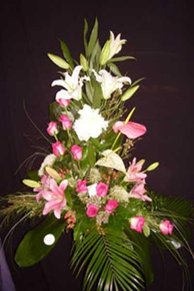 Centro flores tonos rosas